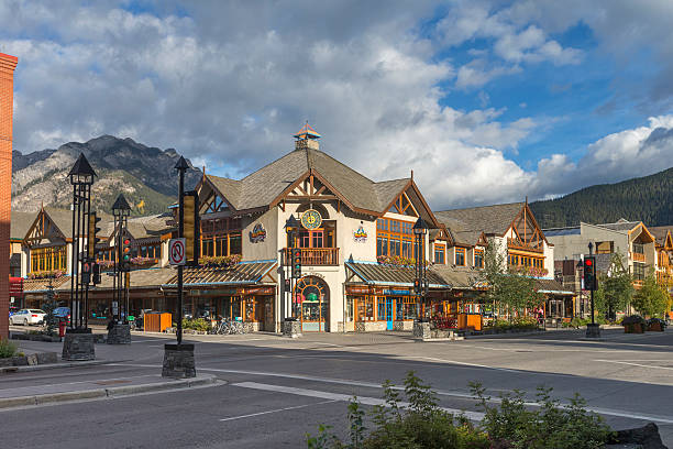 Downtown Streets of Banff National Park Canada Tourists and visitors on the street enjoying the hotels, restaurants and retail facilities of the town of Banff in Banff National Park in Canada. banff national park stock pictures, royalty-free photos & images