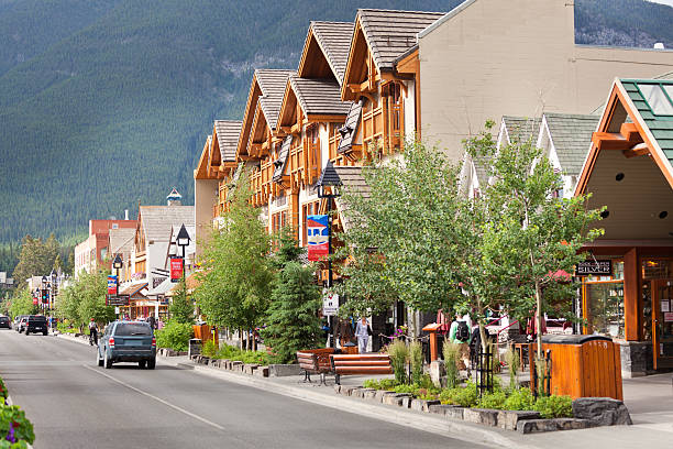 downtown streets of banff national park canada - banff national park stock photos and pictures