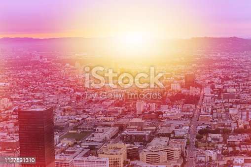 Aerial view of Los Angeles skyline at panoramic terrace of Oue Skyspace in California, United States. Downtown of LA cityscape from observation deck on 70th floor. Sunlight shot.