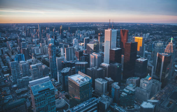 downtown toronto at dusk, canada - toronto stock pictures, royalty-free photos & images