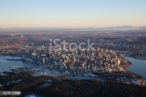 Aerial view of Downtown City during a vibrant sunset. Taken in Vancouver, British Columbia, Canada.