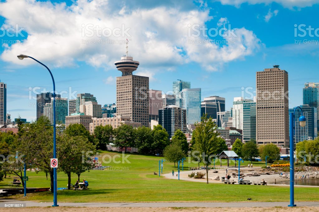Downtown Vancouver, BC skyline on a summer day near the water stock photo