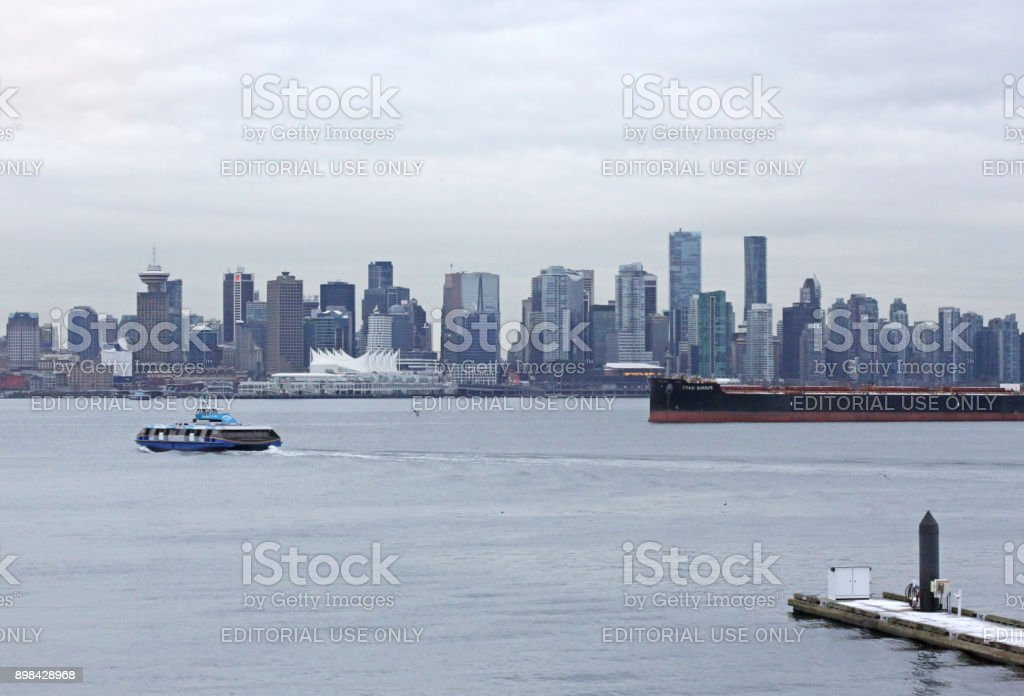 Downtown Vancouver Skyline and SeaBus in Winter stock photo