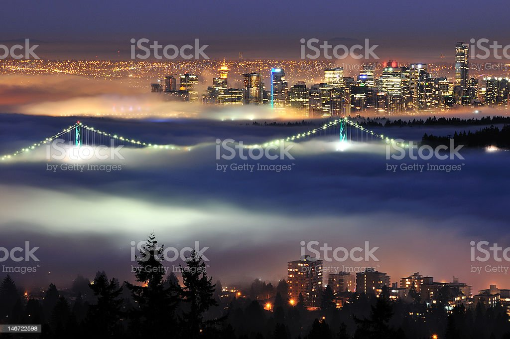 Downtown Vancouver with evening fog stock photo