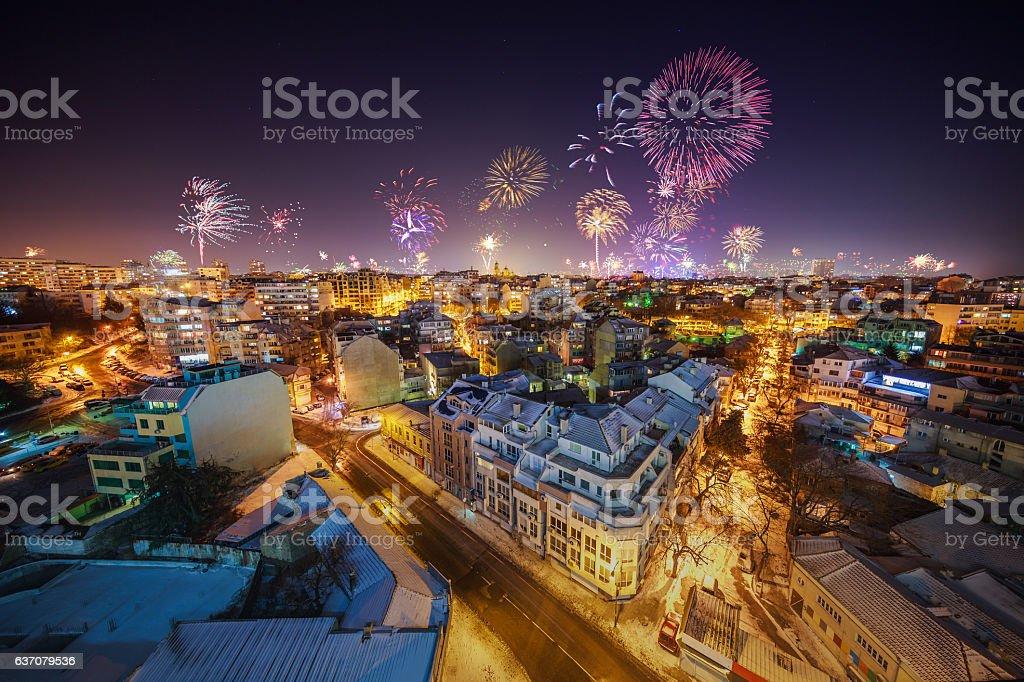 Downtown Varna cityscape with flashing fireworks celebratining stock photo
