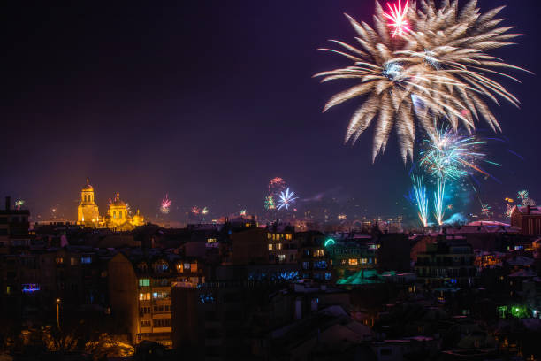 Downtown Varna cityscape with many flashing fireworks celebrating New Year's Eve. stock photo