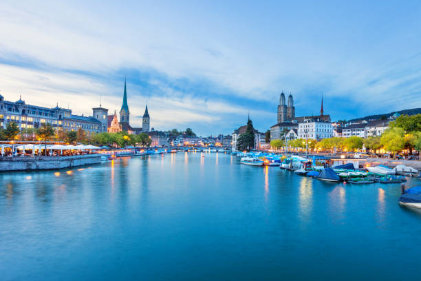 Downtown waterfront in Zurich Switzerland Stock photograph of the downtown waterfront on the banks of the Limmat River in Zurich, Switzerland at twilight blue hour. zurich stock pictures, royalty-free photos & images