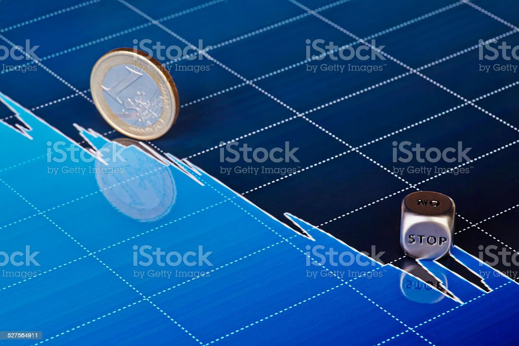 Downtrend chart, one-euro coin and dices cube  STOP stock photo