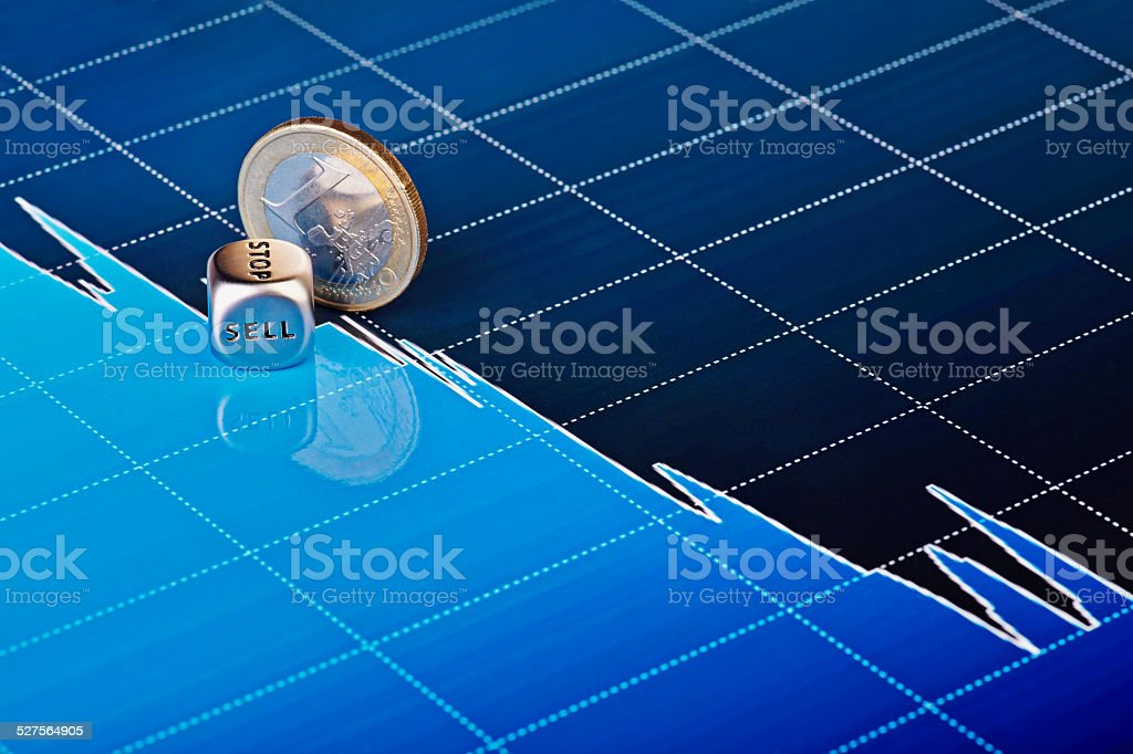 Downtrend chart with one-euro coin and dices cube stock photo