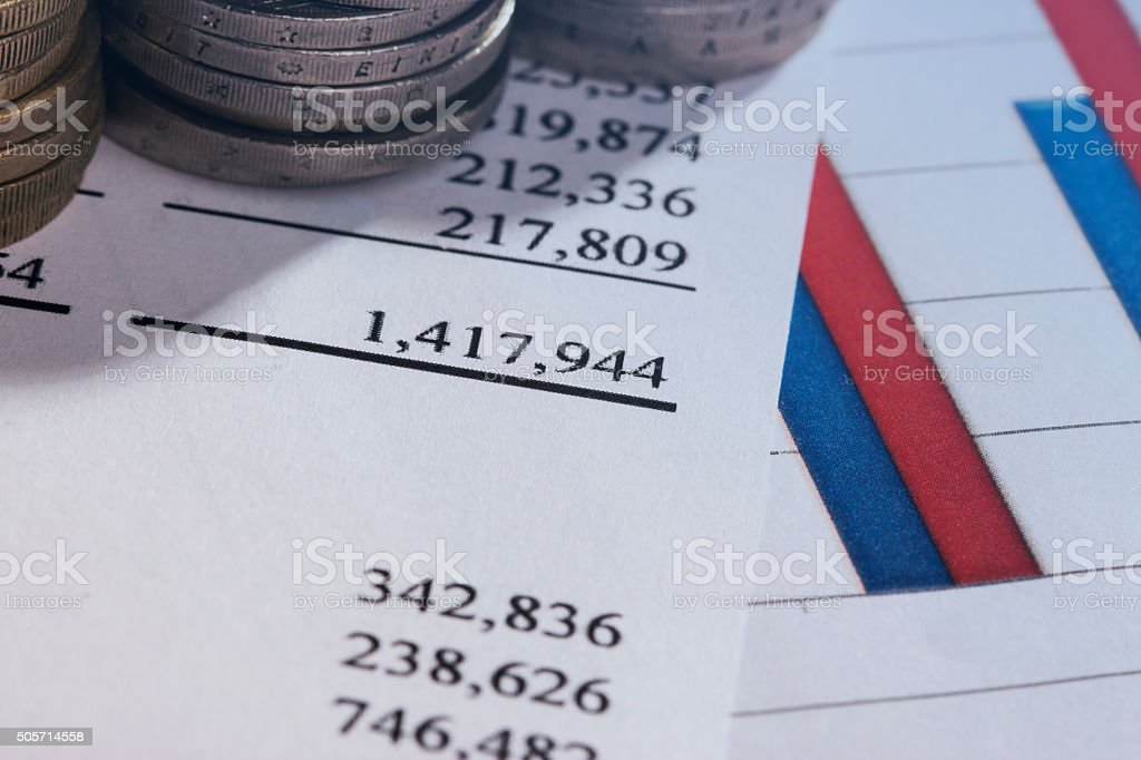Downtrend coins stacks on financial chart. stock photo
