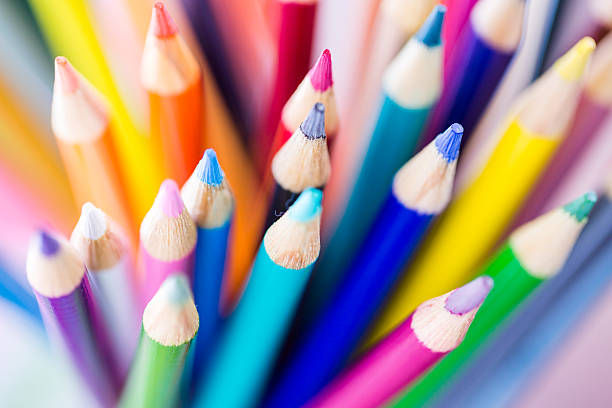 downward view of a variety of sharpened colored pencils - coloured pencil stock photos and pictures