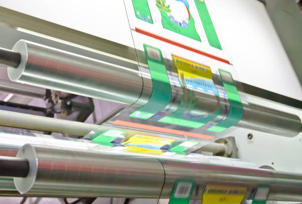 doypack making packaging machine in modern factory with white rolls  and plastic film running stock photo