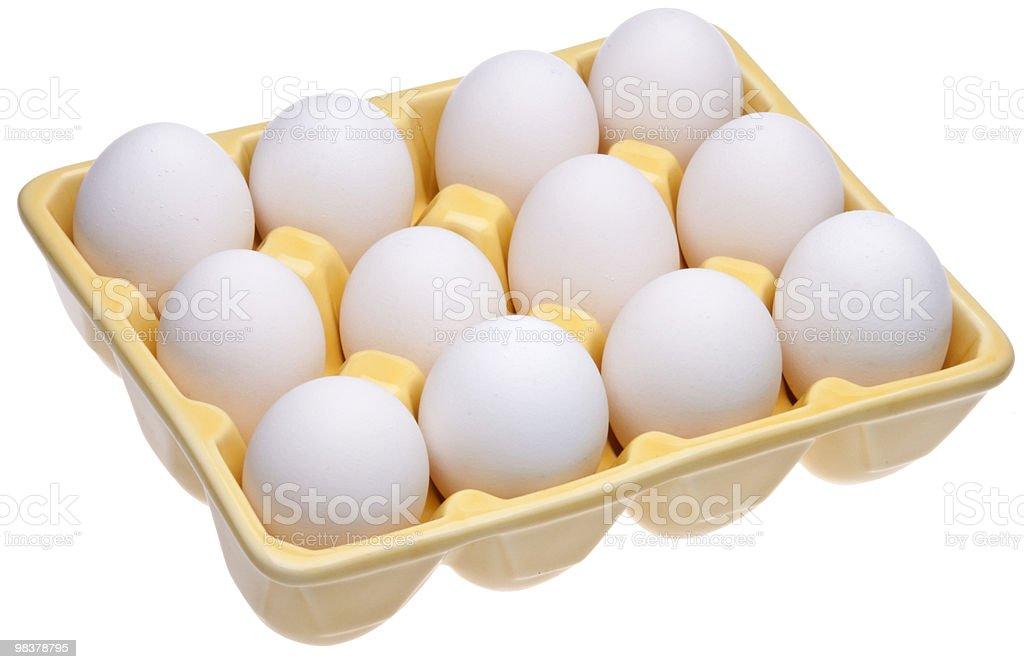 Dozen Eggs in Yellow Open Carton royalty-free stock photo