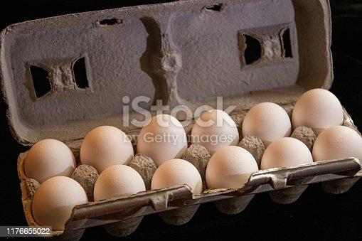 A dozen eggs in a carton.