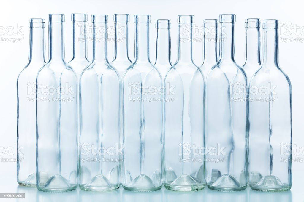 Dozen empty bottles arranged chess-board fashion stock photo