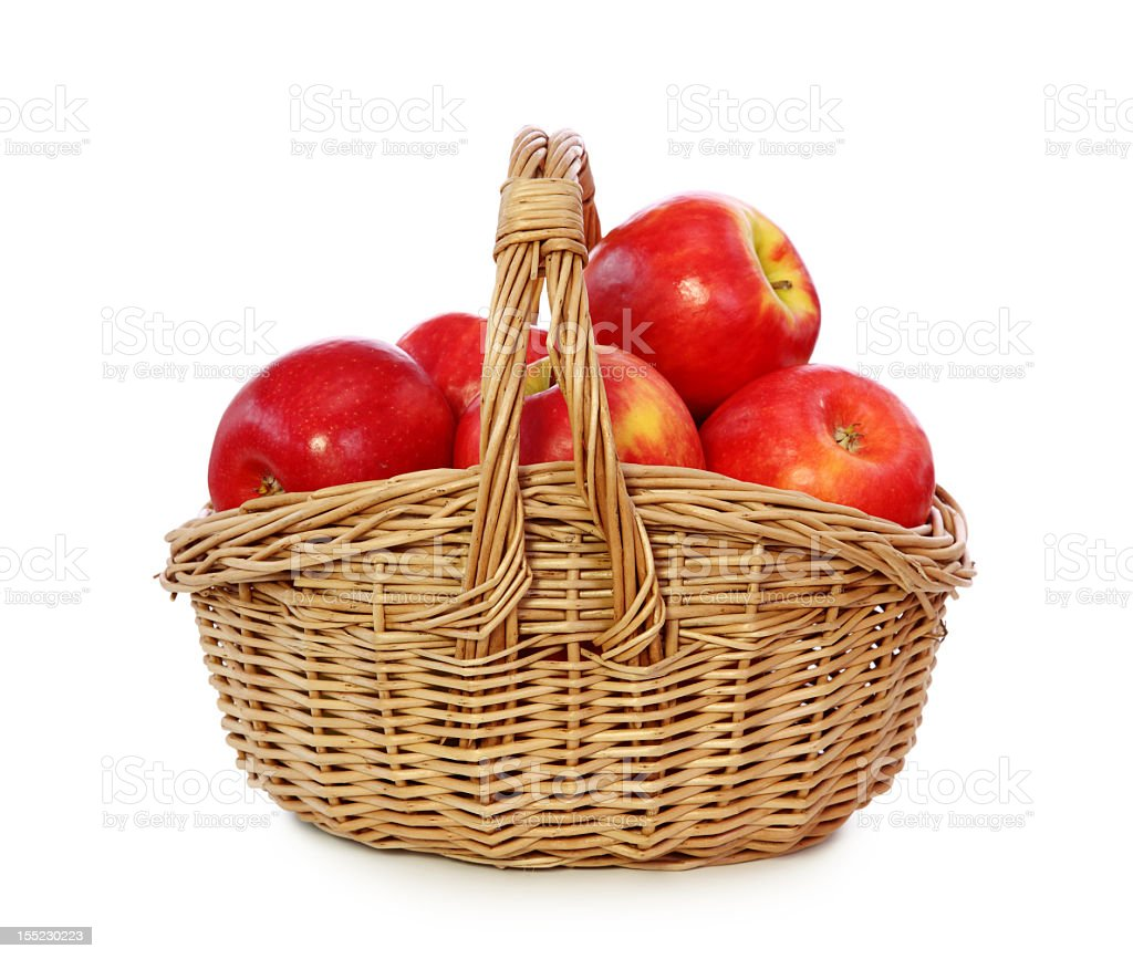 Dozen red apples, in woven basket  royalty-free stock photo