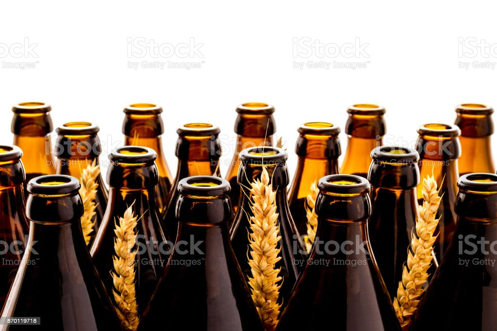 Dozens of empty, brown German beer bottles, isolated as background stock photo
