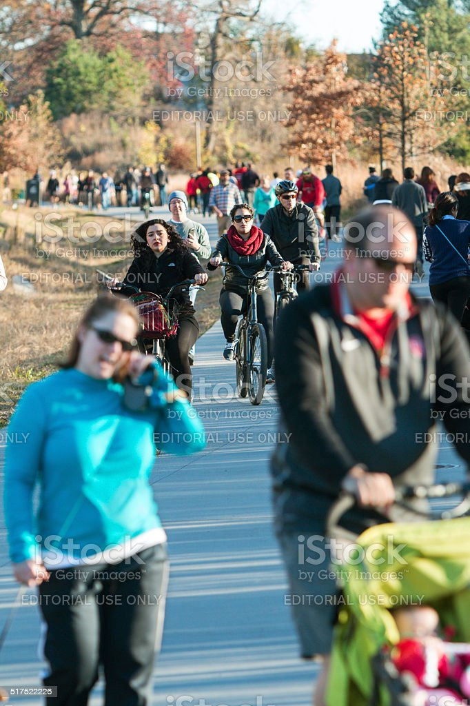 Dozens Walk And Bike In Urban Greenspace Along Atlanta Beltline stock photo