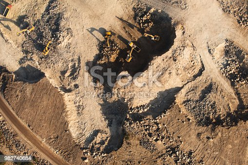 Dozers and trucks at buildings site on top aerial view.
