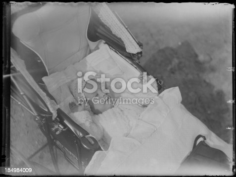 istock dozing baby in pram 184984009