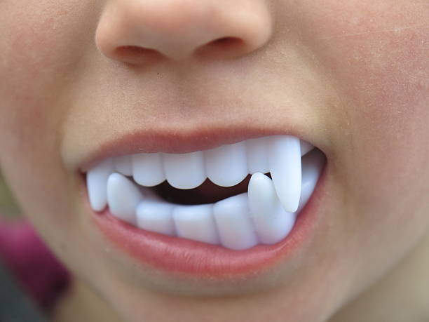dracula plastic children teeth White Plastic Vampire Teeth dracula plastic children teeth fang stock pictures, royalty-free photos & images