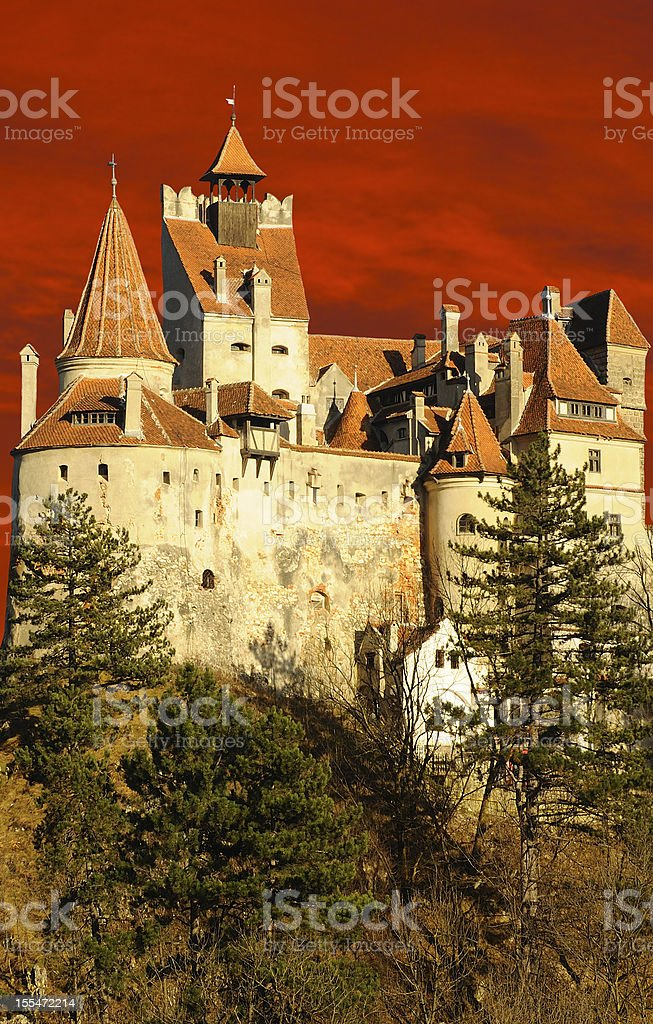 Dracula's Bran Castle illuminated by a dramatic sunset stock photo