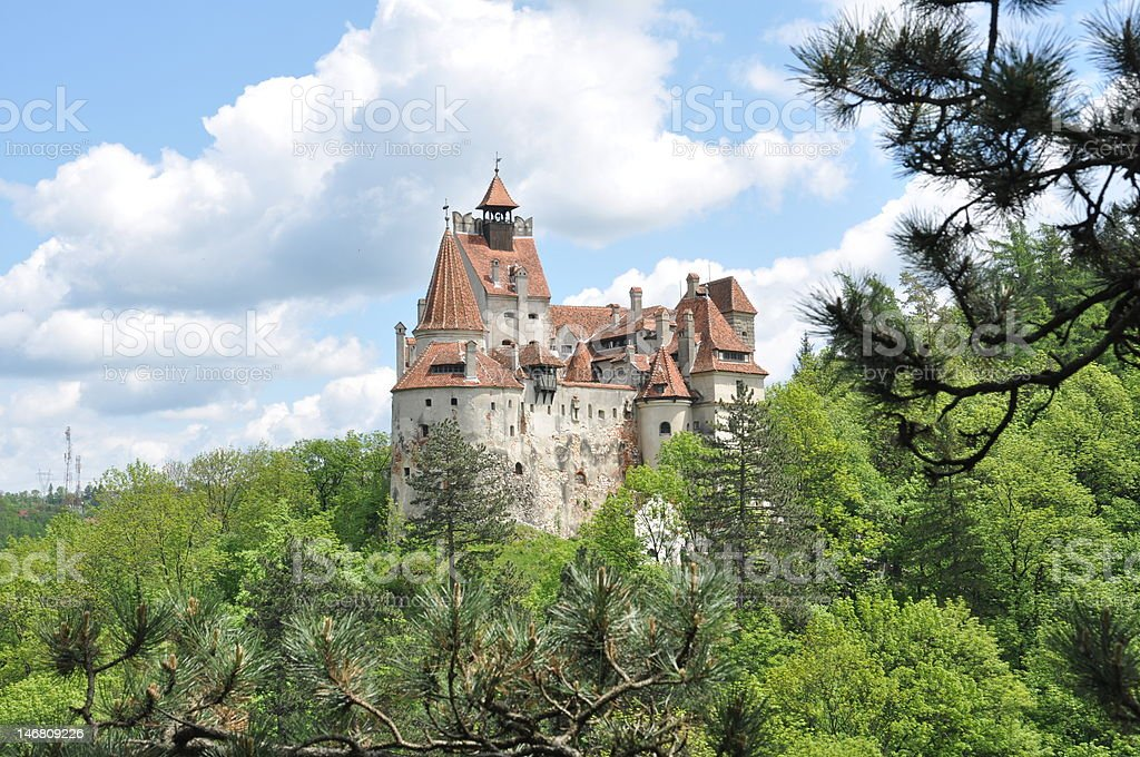 Dracula's Bran Castle in spring season view from the forest stock photo