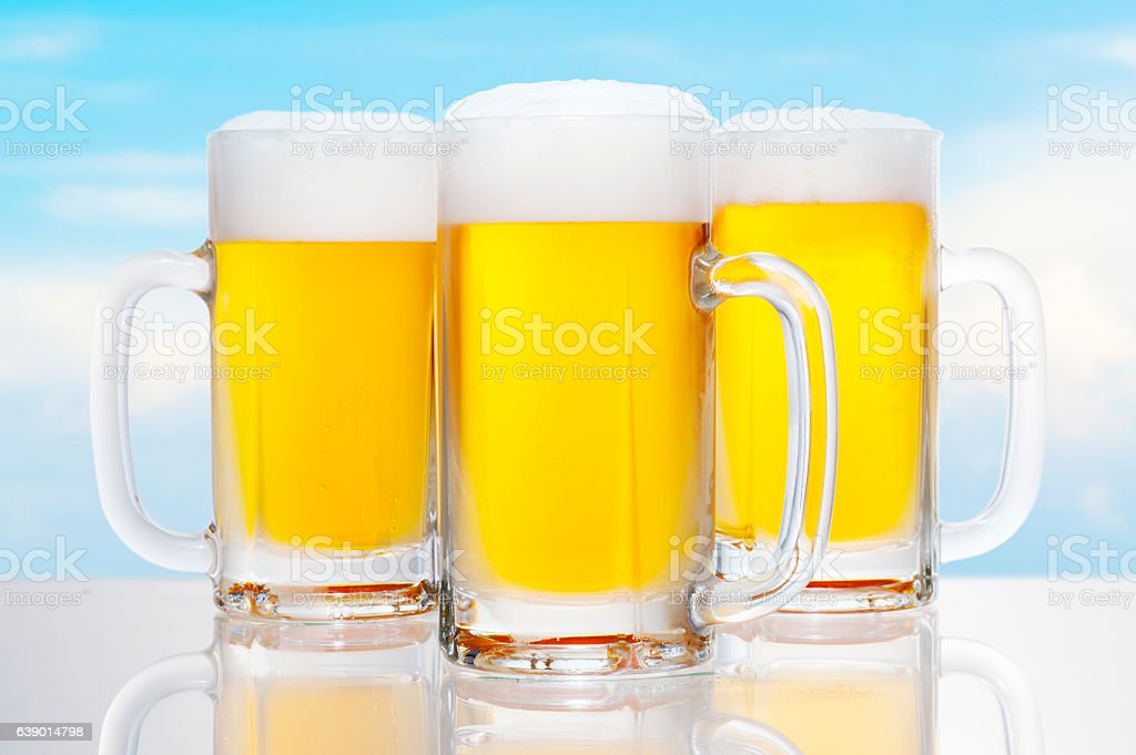 Draft beer in the background of the blue sky stock photo