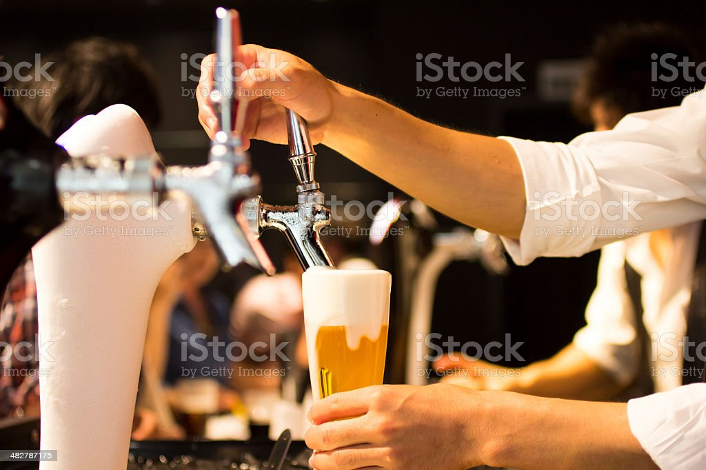 Draft Beer Overflowing stock photo