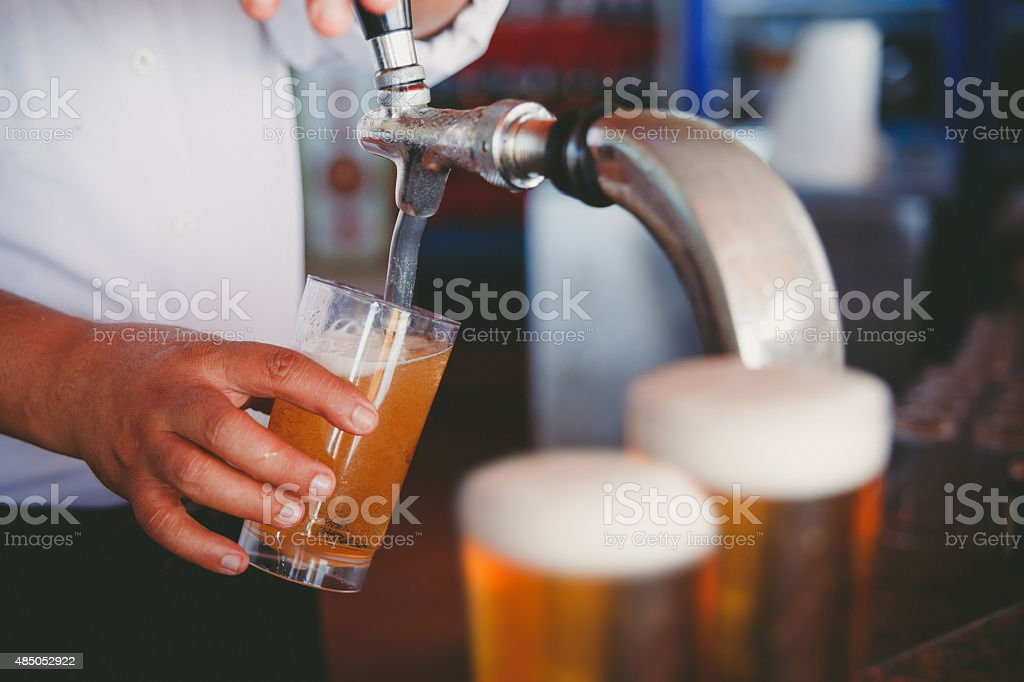 Draft beer pour in a glass stock photo
