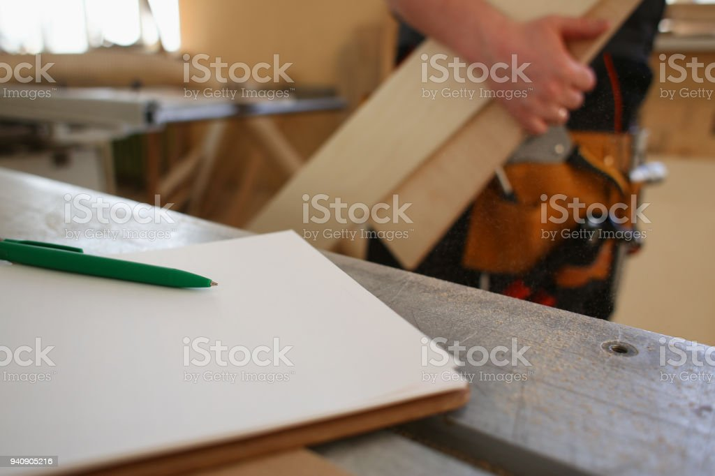 Drafting green pen lying on desk on clipboard stock photo