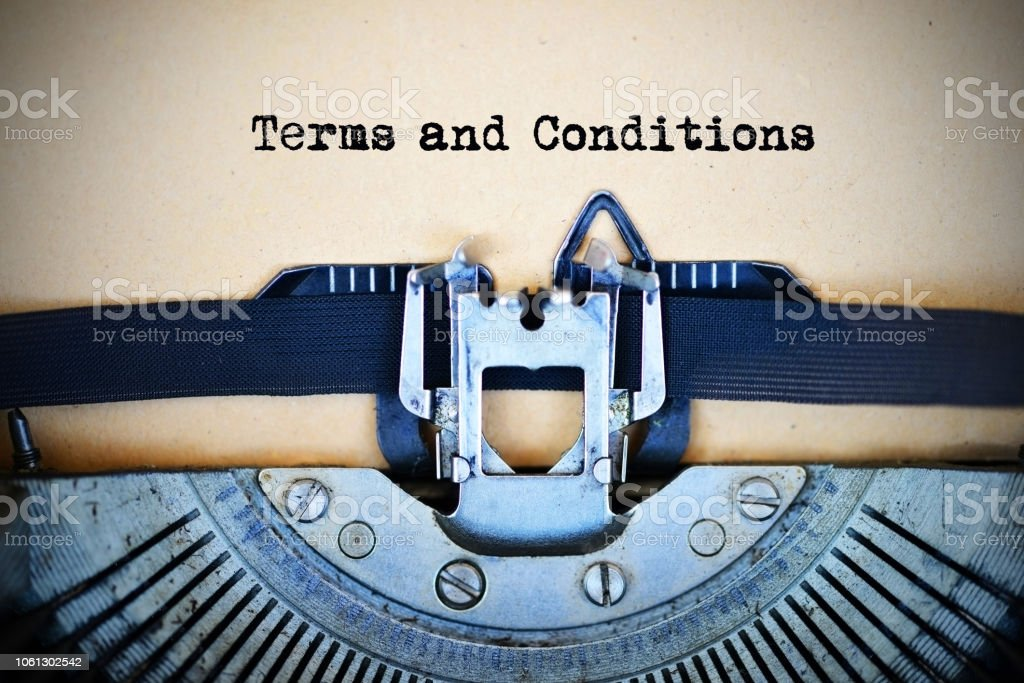 Drafting terms and conditions of an agreement using a retro typewriter stock photo