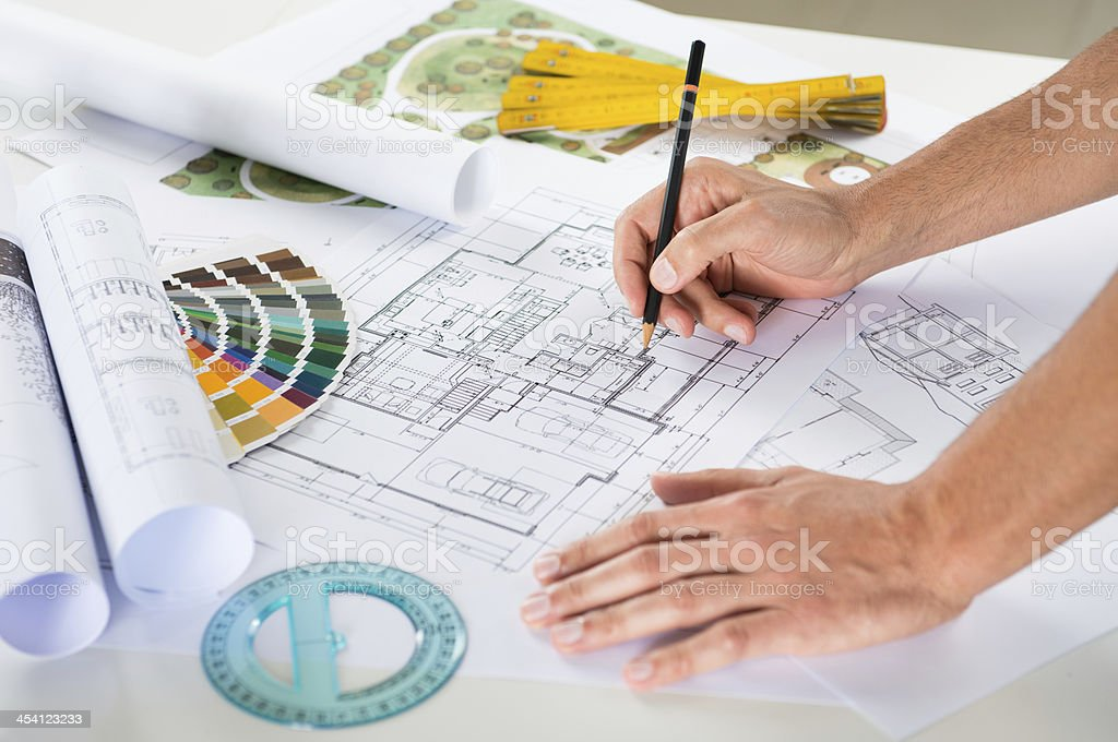 Draftsman Drawing Plan On Blueprint stock photo