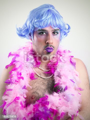 Portrait of a dressed man with a pink wig.