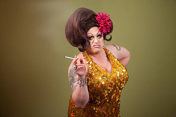 drag queen smoking - transvestite stock photos and pictures