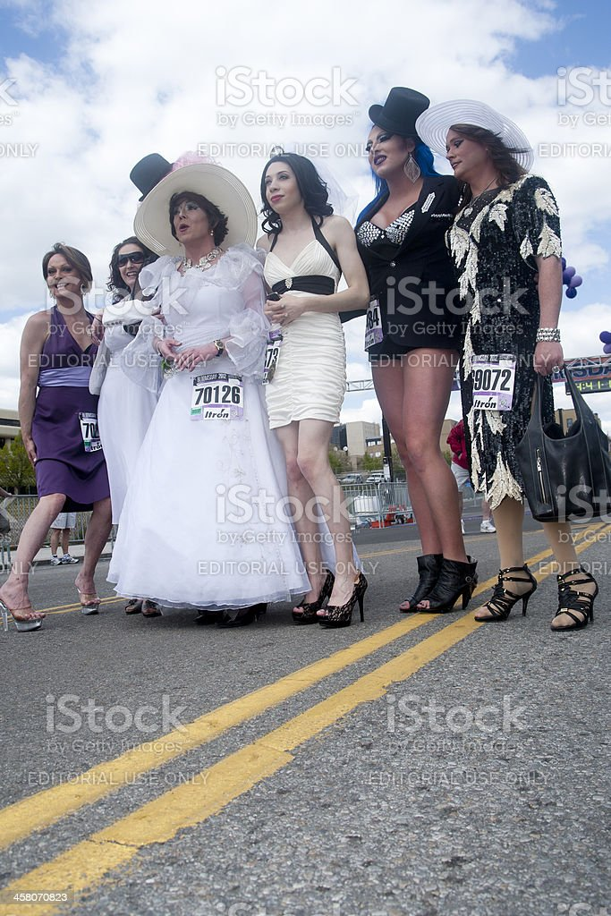 Drag queens pose on the road. stock photo