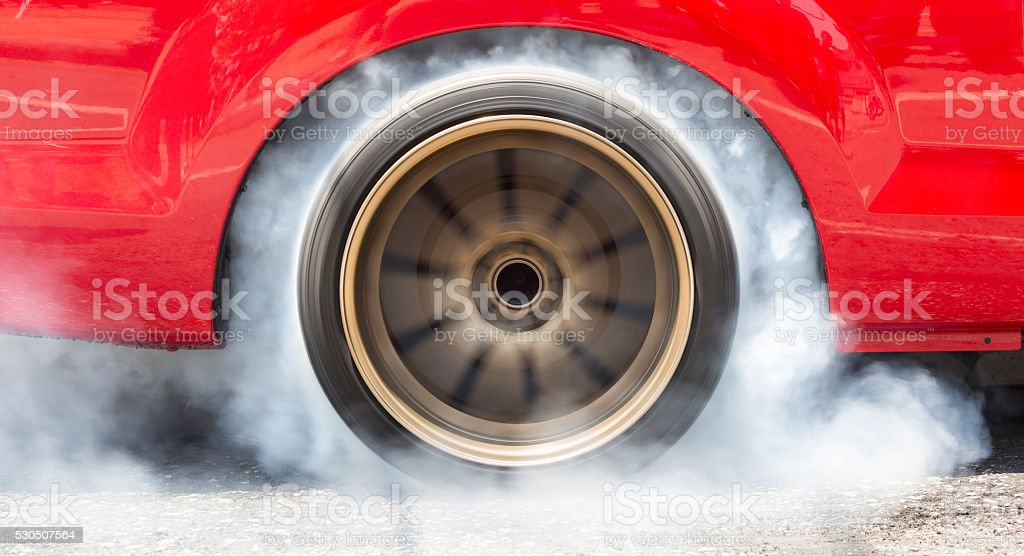 Drag racing car burn tire for the race stock photo