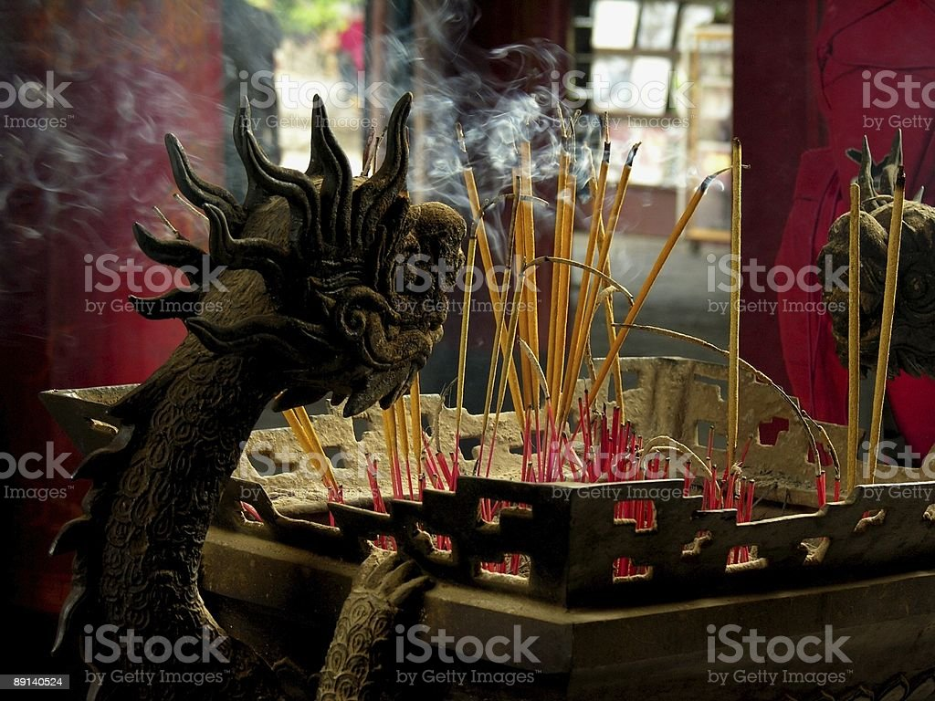 dragon and incense sticks royalty-free stock photo