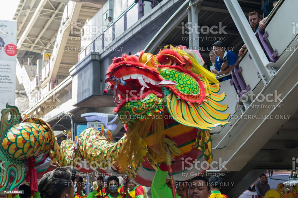 Dragon and lion dance show in chinese new year festival. stock photo