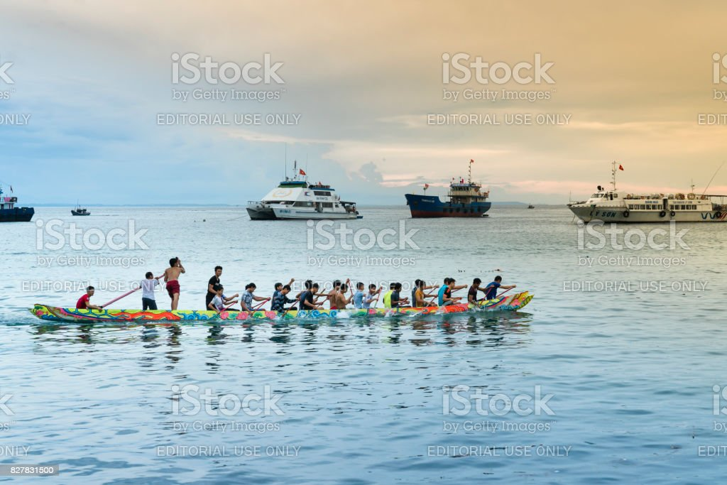 dragon boat racing of young men's on Ly Son island, Quang Ngai province, Vietnam. stock photo