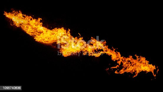 Dragon breathing flame, fire stream isolated on black