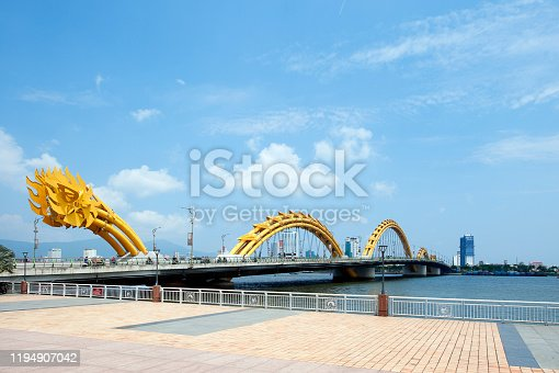 Dragon Bridge over the River Hàn at Da Nang, Vietnam. The dramatic yellow sculpted and arched steel tube and cut metal sheet Dragon Bridge constructed over the River Hàn at Da Nang, Vietnam.