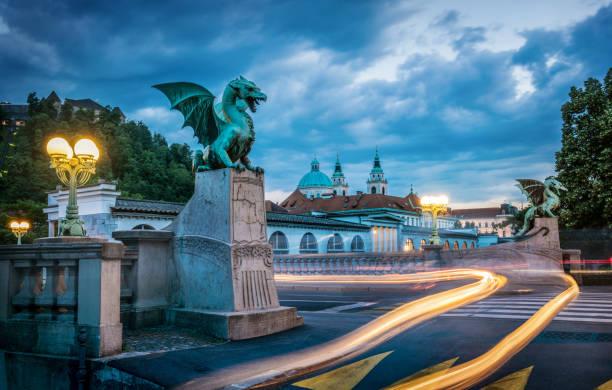 Dragon bridge (Zmajski most), symbol of Ljubljana, capital of Slovenia, Europe. Long exposure. Time lapse. stock photo