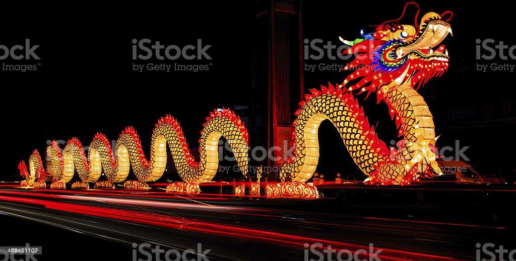 A dragon display illuminated in the night stock photo