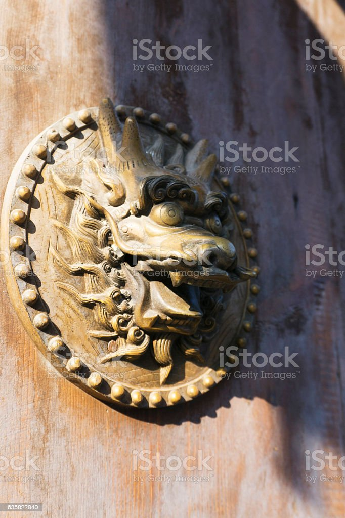 Old Chinese brass door knocker with dragon carved