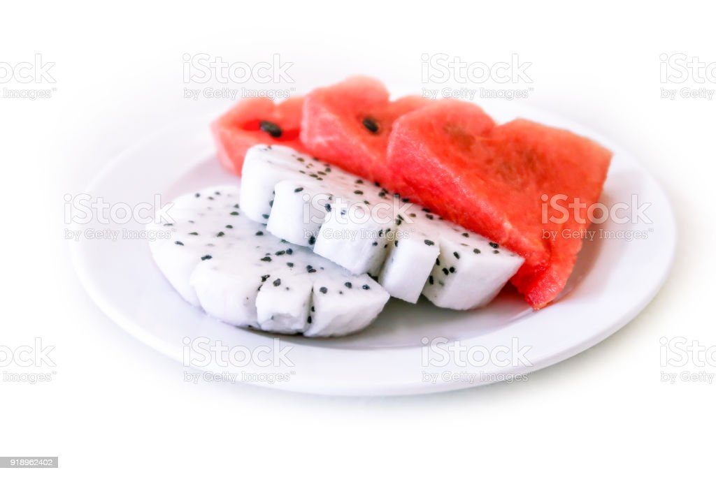 Dragon fruit and watermelon in dish on white background stock photo