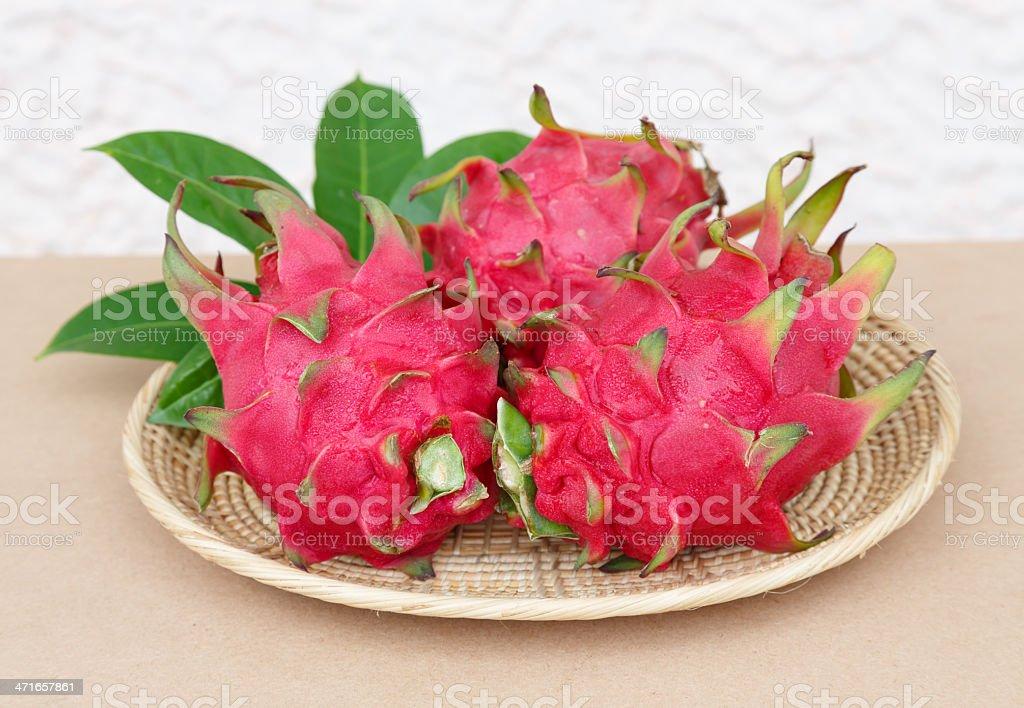 dragon fruit in basket on wooden desk royalty-free stock photo