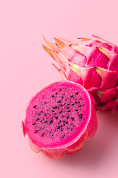 Dragon fruit Fresh organic red dragon fruits on a pink background pitaya stock pictures, royalty-free photos & images