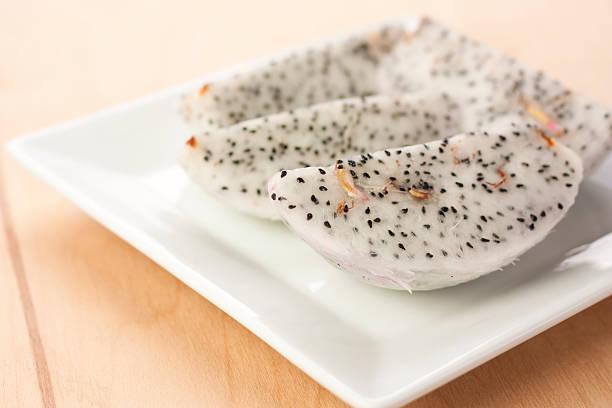 Dragon fruit slices on a plate stock photo