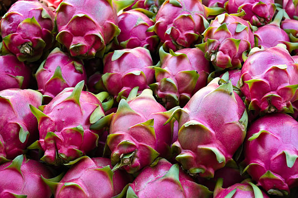 Dragon Fruits Dragon fruit for sale in a market place pitaya stock pictures, royalty-free photos & images